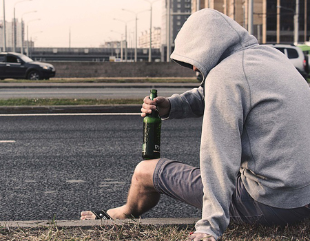 Person on road with beer